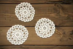 Three White Round Place Mat On Wooden Background Royalty Free Stock Photo