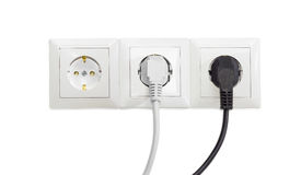 Three white socket outlet with two connected corresponding power. Three white socket outlets with two connected corresponding power plugs royalty free stock photo