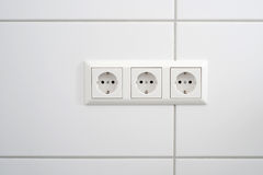 Three white sockets Royalty Free Stock Images