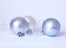 Three white spheres and streamer Royalty Free Stock Photos
