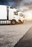 Three white trucks in a row Royalty Free Stock Image