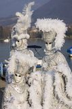 Three white venetian mask at Annecy's carnival. Annecy, France - February 18, 2009: Tree white venetian mask in front of Annecy's lake at venetian carnival Stock Photography