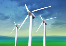Three white wind turbines Royalty Free Stock Image