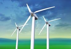 Three white wind turbines Royalty Free Stock Image