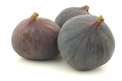Three whole figs (Ficus carica) Stock Images