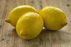 Three whole fresh lemons Royalty Free Stock Image