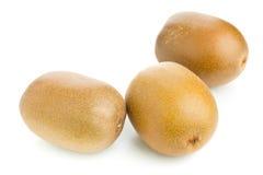 Three whole golden kiwifruit/ kiwi Royalty Free Stock Photography