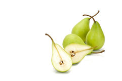 Three  whole green pears and one halved Stock Photos