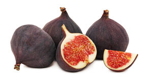 Three whole and a half ripe figs (isolated) Stock Photography