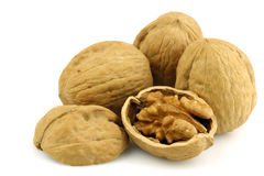 Three whole and an opened walnut Stock Photo