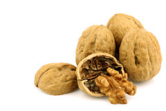 Three whole and an opened walnut Royalty Free Stock Images