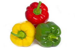 Three whole Paprika peppers Stock Photos