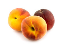 Three whole peaches. On white background Stock Photo