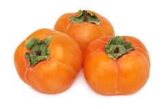Three whole persimmons (isolated) Stock Photo