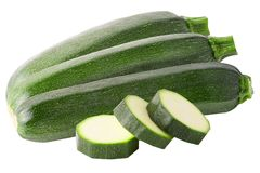 Three whole and slices zucchini isolated on white stock images