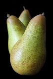 Three whole standing pears Stock Image
