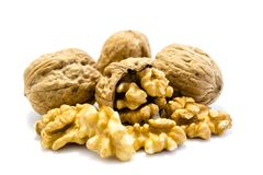 Three whole walnuts and one cracked isolated on white background royalty free stock images