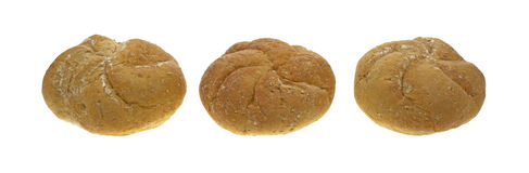 Three whole wheat rolls in a row Stock Photos