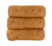 Three whole wheat sub rolls on a white background Royalty Free Stock Photo