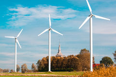 Three wind farms and church Royalty Free Stock Photos