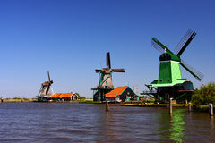 Three wind mills on lake Stock Photo
