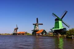 Three wind mills on lake. Three wind mills on the lake Stock Photo