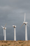 Three wind power generators. Stock Photo