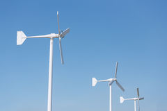 Three wind turbine on blue sky Stock Photo