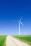 Three wind turbines Stock Images