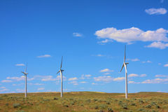 Three Wind Turbines. On the prairie with blue sky royalty free stock images