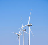 Three Wind Turbines, Against a Blue Sky Stock Photo