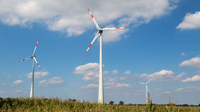 Three wind turbines on a cornfield Royalty Free Stock Photos