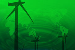 Three wind turbines on green planet background Royalty Free Stock Image