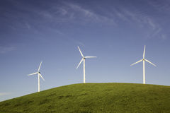 Three Wind Turbines on a Hill Royalty Free Stock Photography