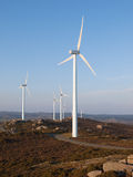 Three wind turbines in a landscape. Stock Images