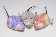 Three wind-up toy mice Stock Photos