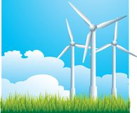 Three windmills. Three white windmills on grass with blue sky background Stock Photography