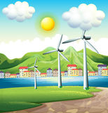 Three windmills across the village Stock Images