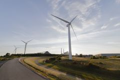 Three windmills curved path, summer sky day time royalty free stock photos