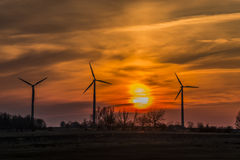 Three windmills with sunset Stock Photo