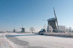 Three windmilsl in winter scenery Royalty Free Stock Photos