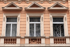 Three window of brown building Royalty Free Stock Photo