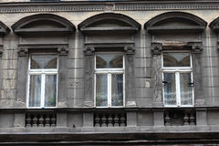 Three window of grey building Royalty Free Stock Photos