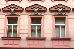 Three window of red building Stock Image