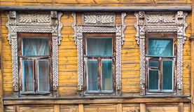 Three window on a yellow wooden wall Royalty Free Stock Photography