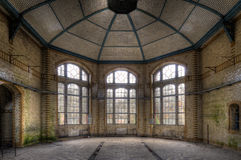Three windows. The old hospital complex for lung diseases in Beelitz near Berlin which is abandoned since 1992 Stock Photo