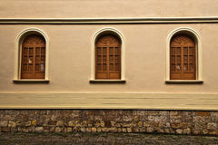 Three Windows. The windows and a colonial wall in Bogota, Colombia Royalty Free Stock Image