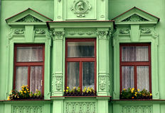 Three windows. Front elevation in a green with three Royalty Free Stock Photo
