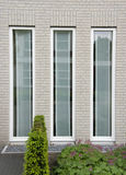 Three windows. Three vertical windows in a brick wall stock photography