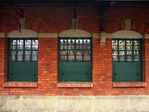 Three windows. And red brick wall royalty free stock images
